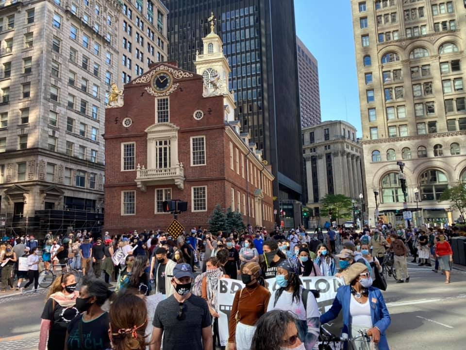 Indigenous Peoples Day March moving past the old State House in Boston
