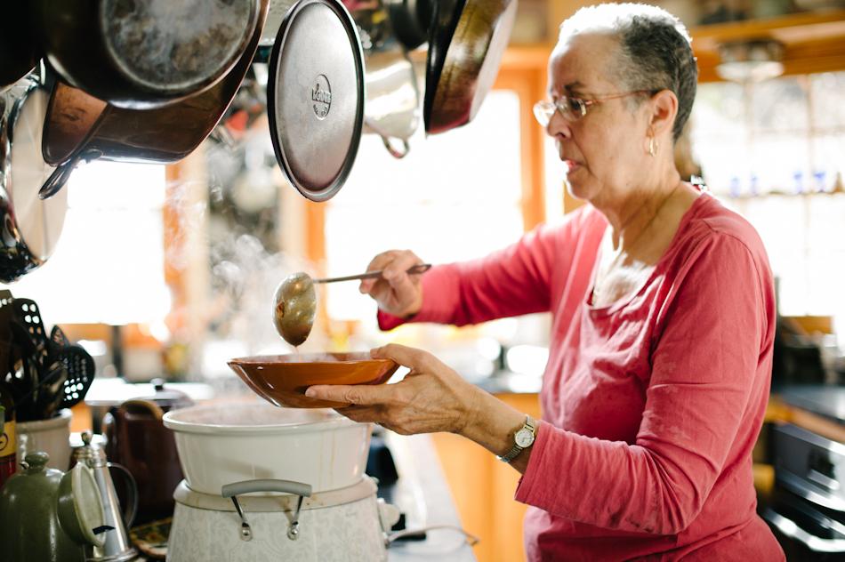 Leni Sorensen PHD serving soup in her kitchen at Indigo House