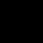 A man walks past a screen displaying a logo of Volkswagen at an event in New Delhi.