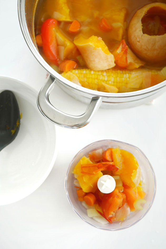 Top down view of vegetables in a food processor.