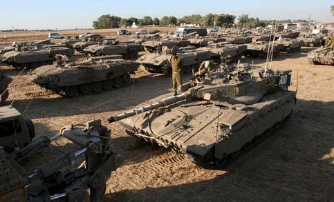 https://i1.wp.com/www.indybay.org/uploads/2009/01/10/13_israeli_tanks_at_the_gaza_strip_borders__file_2007_1.jpg?resize=483%2C293&ssl=1