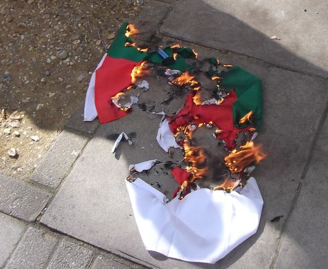 A Bulgarian flag being burnt outside the Embassy