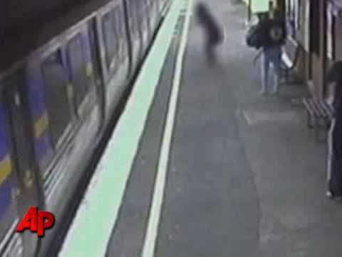Stroller With Baby Falls Underneath Moving Train