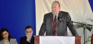 CEO of Qualfon Mike Marrow speaking at the sod turning ceremony of the -building campus at Providence.