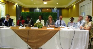 Minister Ashi Singh is flanked by UN representatives. [iNews' Photo]