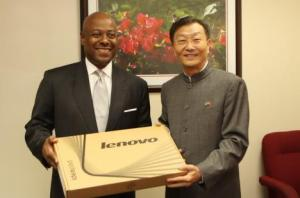 Bahamas Minister of Tourism Obie Wilchcombe (L) on September 3, 2013, accepted a gift of Lenovo laptop computers on behalf of Bahamas Information Services from Hu Shan, China's ambassador to The Bahamas. (BIS Photo/Patrick Hanna)