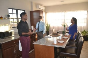CEO of Windsor Estates Danny Sawh explaining features of the company's model home to Prime Minister Samuel Hinds and Mrs. Yvonne Hinds.
