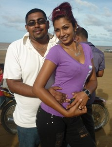 Ricky Ross and Tasleema Mohamed on the 63 beach in Berbice, the last day the two dwelled as a couple.