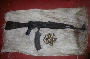 The AK 47 and rounds which were retrieved by the Police.