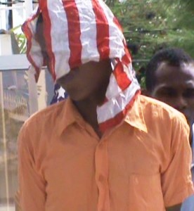 Shermon Hinds hides his face as he exits the Georgetown Magistrate's Court. [iNews' Photo]