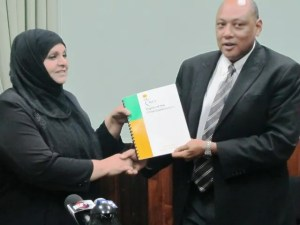 Chairperson of the Commission, Aleema Nasir hands over the report to Speaker Trotman. [iNews Photo]