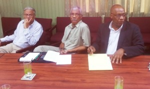 Leader of the APNU, David Granger (center) flanked by Executive Members, Joseph Harmon (right) and Dr. Rupert Roopnarine (left). [iNews' Photo]