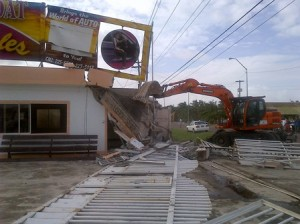 Public Works Ministry demolishing the illegal structure. [iNews' Photo]
