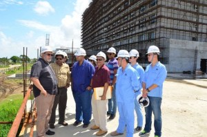 President Donald Ramotar in discussion with Finance Minister Dr Ashni Singh, Head of the Privatisation Unit Winston Brassington and workers and project managers at the Marriott Hotel.