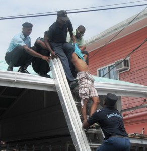 Police officers apprehend the teen. [iNews' Photo]