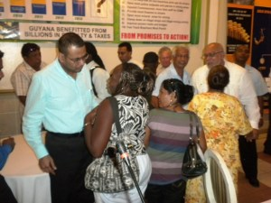 Minister of Natural Resources and the Environment, Robert Persaud interacts with miners.