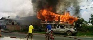 The house engulfed in flames.