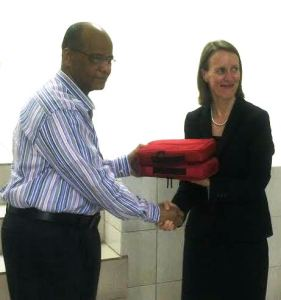 Canadian High Commissioner to Guyana Dr. Nicole Giles (left) hands over one of the kits to Home Affairs Minister, Clement Rohee. [iNews' Photo]