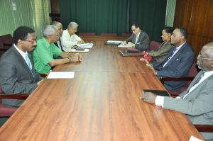 APNU Leader, David Granger along with other Party members meet the Commissioners of the Walter Rodney COI.