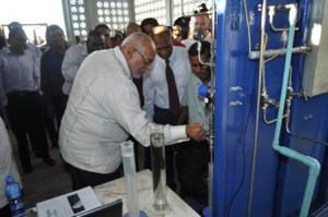 President Donald Ramotar releasing bio-fuel from the Albion plant