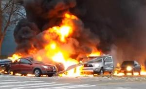 At least two vehicles were consumed by flames in the crash.