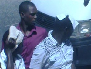 Curtly and Clifford Thomas hide their faces as they entered the Georgetown Magistrate's Court. [iNews' Photo]