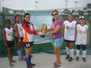 Guyana Hockey Board Hon. Secretary, Tricia Fiedtkou, presents the Degree