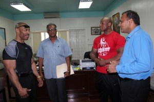 Sport Minister, Dr. Frank Anthony (first from right) followed by Jeff Beckham, Sport Director Neil Kumar and Hugh Ross.