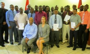 Dr. Giles and Minister Rohee, along with participants of the programme. [iNews' Photo]