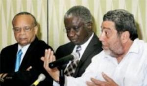 Prime Minister Dr. ralph Gonsalves (right) falnked by his Barbados counterpart Freundel Stuart (center) and Chairman Jean Holder.
