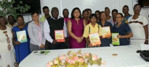 Minister of Education,  Priya Manickchand with the team of contributors at the launch of Primary Science Text Books