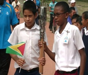 Students get a feel of the Queen's Baton. [iNews' Photo]