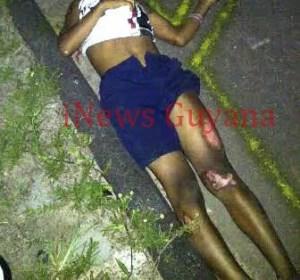 The lifeless body of Robin Hernandez lies on the roadway.