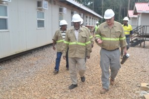 Prime Minister Samuel Hinds, and Vic Rozon, General Manager for Aroura Gold Mines during the tour of the construction site.