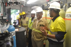 Prime Minister Samuel Hinds touring the operations Plant at Aroura Gold Mines.