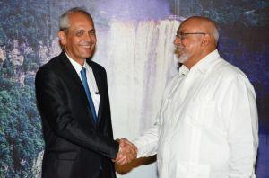 President Donald Ramotar greets Michael Prom, the new Ambassador of France to Guyana