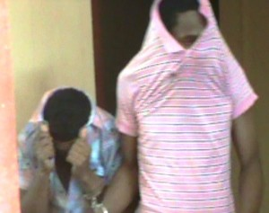 Akeem Halton (in the pink) followed by his young accomplice. [iNews' Photo]