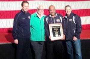Wayne James shows off his award.