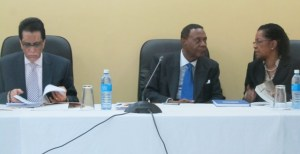 Chairman of the Commission Sir Richard Cheltenham (center) flanked by Jacqueline Samuels Brown (right) andS eenath Jairam. [iNews' Photo]