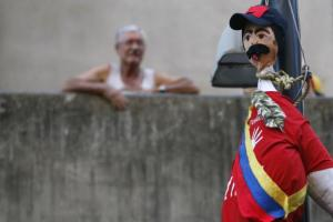 An effigy depicting Venezuela's President Nicolas Maduro hangs on a pole during riots in Caracas