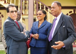 Chairman of the Commission, Sir Richard Cheltenham (right) along with other Commissioners. [iNews' Photo]