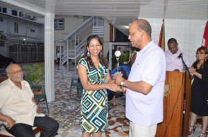 A member of the Guyana-Cuba Friendship Association presents to Minister of Home Affairs and General Secretary of the People's Progressive Party (PPP) Clement Rohee a token of appreciation for promoting Guyana-Cuba friendship
