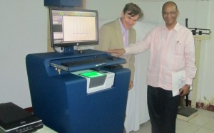 Home Affairs Minister, Clement Rohee and US Ambassador to Guyana, Brent Hardt examine the equipment. [iNews' Photo]
