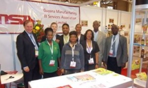 GMSA's Co-ordinator for Trade & Investment, Clement Duncan (right) with the Guyanese exhibitors at the SIAL 2011 trade show in Toronto