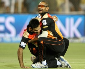 Shikhar Dhawan embraces Irfan Pathan after the latter took a skier