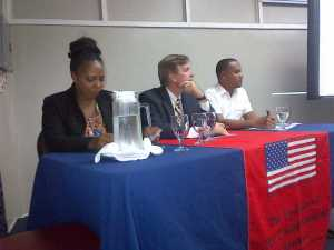 US Ambassador, Brent Hardt (center) flanked by Mark Murray (right) and Carolyn Walcott.