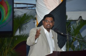 Minister of Tourism (ag) Irfaan Ali speaking at the launch of GuyExpo 2014