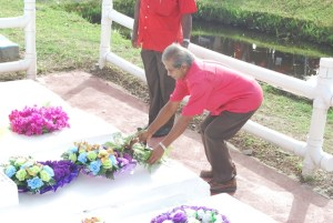 Komal Chand lays a wreath at the burial site for the Enmore Martyrs' at Le Repentir Cemetery.