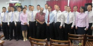 Health Minister, Dr Bheri Ramsarran with the new Chinese Medical Team. [iNews' Photo]