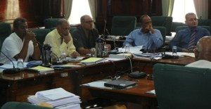 Minister of Agriculture, Dr L eslie Ramsammy flanked by CEO of GuySuCo, Dr Rajendra Singh (right) and Finance Director, Paul Bhim. [iNews' Photo]
